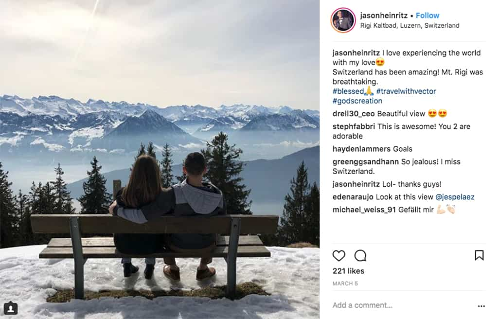 couple sitting in front of mountains in Switzerland during Vector travel