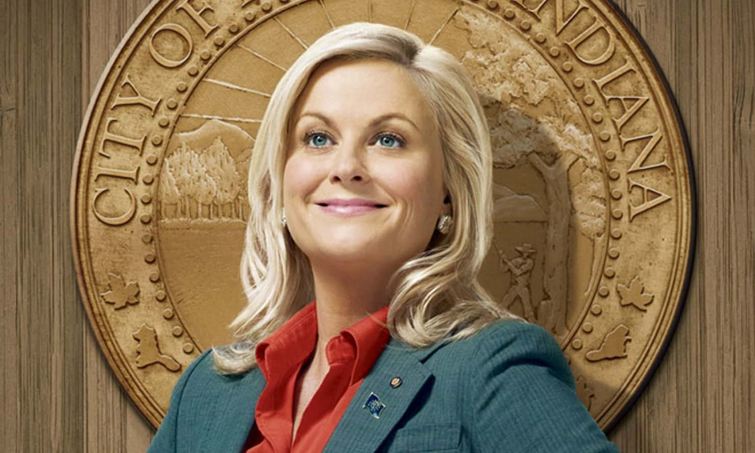 Amy Poehler, smiling, as Leslie Knope in Parks and Rec