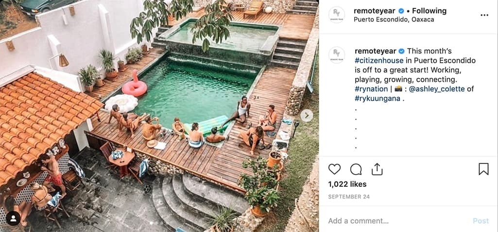 People socializing by a pool