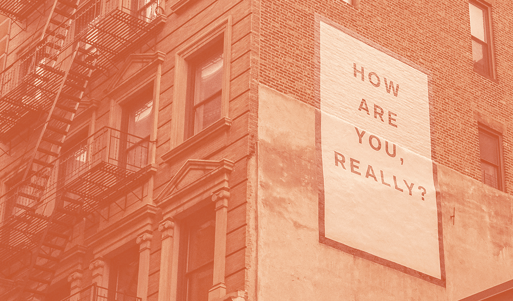 """Sign on building, """"How are you, really?"""""""