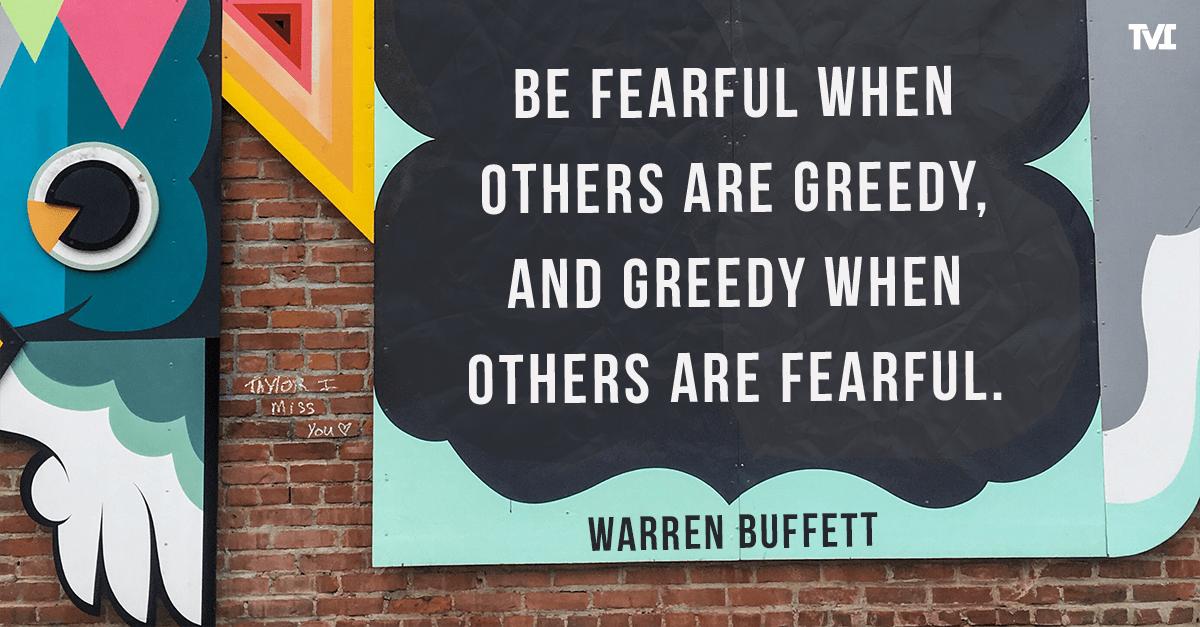 "Warren Buffet quote on colorful wall: ""Be fearful when others are greedy, and greedy when others are fearful."""