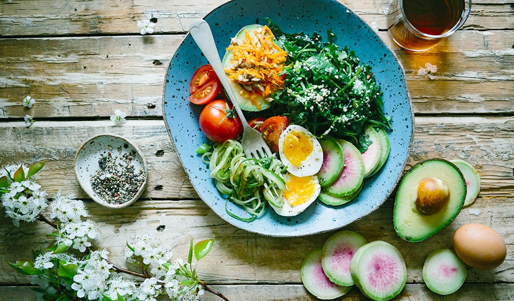 salad and vegetables on wooden table