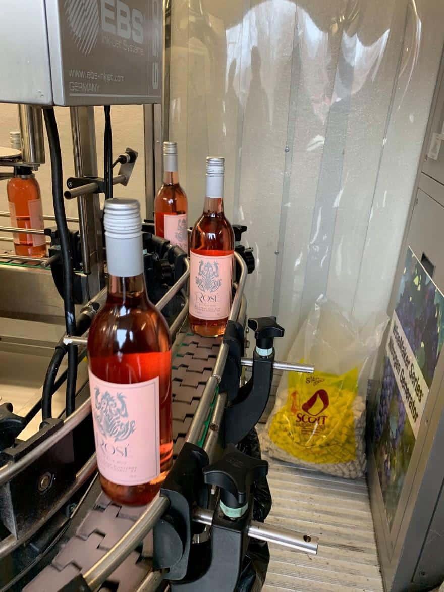 wine bottles on an assembling line