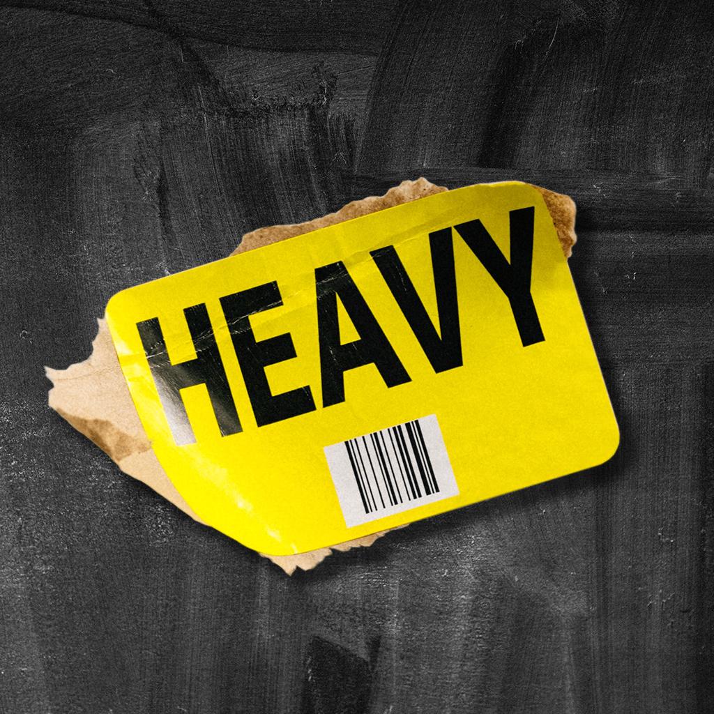"""heavy"" label on black texture"