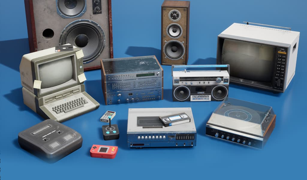 vintage electronics including speakers, computer, television, tape player, VCR, radio, portable gaming system