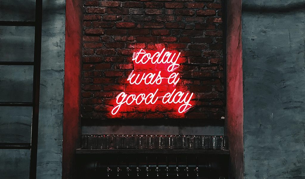 """""""Today was a good day"""" lit up sign against brick wall"""