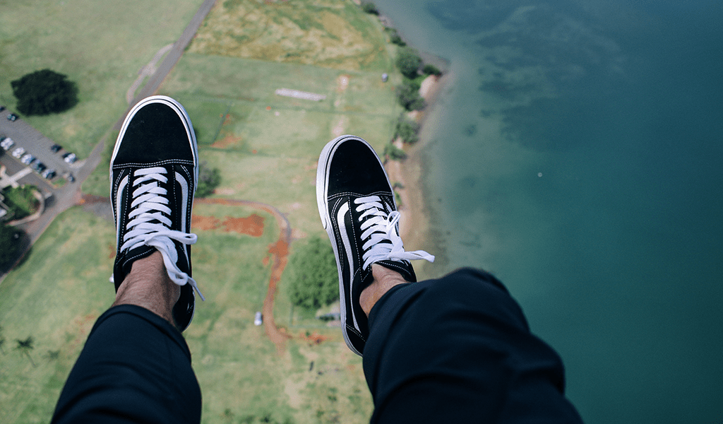 feet dangling up high, getting ready to skydive