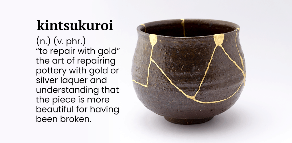 A kintsukuroi broken bowl repaired with gold.
